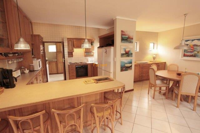 Open plan kitchen, dining and living area which lead onto balcony with view